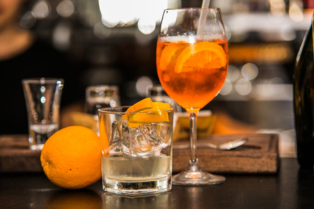spritz: Aperol Spritz cocktail with ice in the bar background