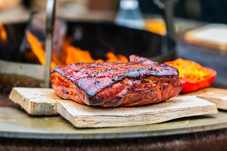 Fresh, delicious grilled meat. Grilling steak on BBQ. Close up view of grilling steak Foto de archivo