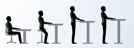 ergonomic. Height adjustable desk or table sitting and standing pose of a man. Saddle chair Фото со стока - 69259522