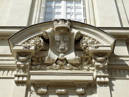 chinon: Detail above the front door of a house  coat of arms Chinon with decorations