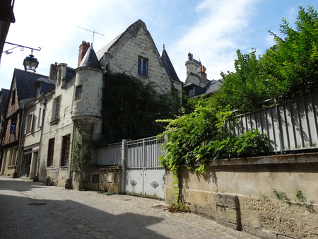 chinon: House with towers in a street of Chinon with the the castle in the background Stock Photo