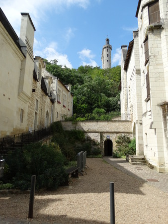 chinon: Medieval street in Chinon with castle in the background Stock Photo
