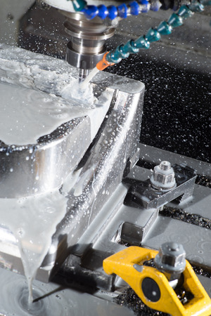 milling center: stop motion of CNC machining center milling a part of mould while using coolant.