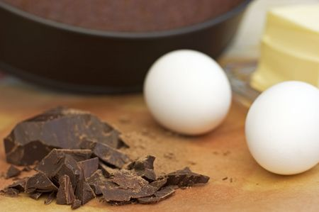 сooking: �ooking chocolate cake. Butter, eggs, chocolate and cocoa.