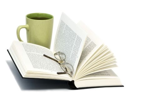 Open book with glasses and cup of tea Stock Photo