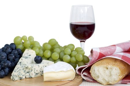 Still life with red wine, cheese, bread and grapes photo