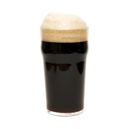 glass with dark beer on white background photo