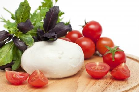 Mozarella cheese with tomatos and basil