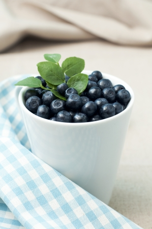 Cup of fresh blueberries, selective focus Stock Photo