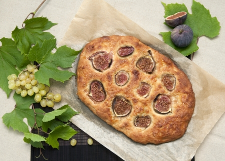 A loaf of sweet bread, fresh from the oven, topped with figs Stock Photo