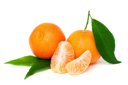 fresh tangerine fruits with green leaves isolated on white background Stock Photo - 16511233