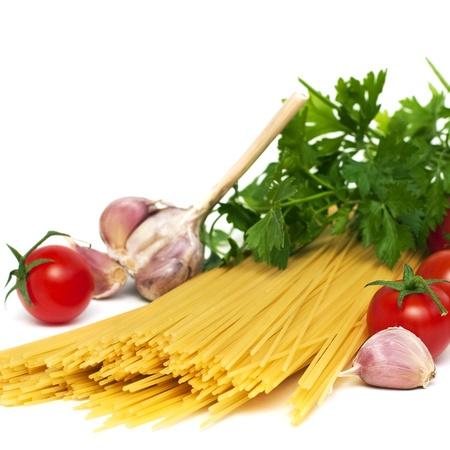 Spaghetti ingrednients: pasta, tomatoes, garlic, herbs