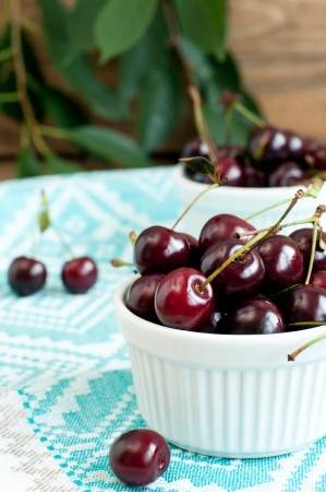 Fresh juicy cherry on the table, selective focus, vertical Stock Photo