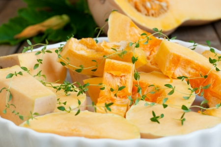 Backing dish with butternut squash and thyme, ready for backing, selective focus, horizontal Stock Photo