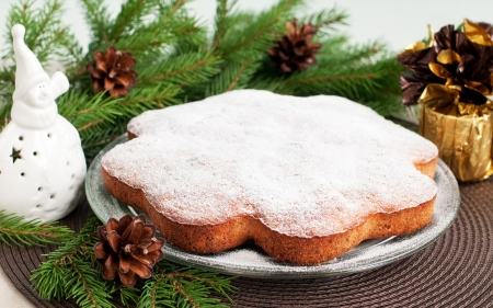 Traditional christmas cake on plate and christmas decorations, horizontal