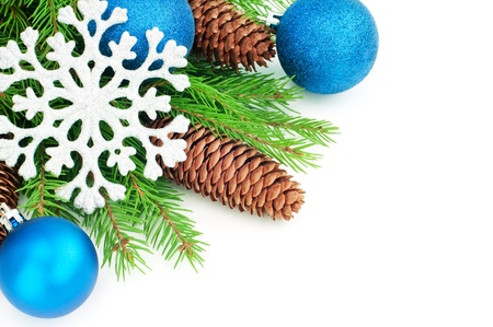 Christmas balls and fir branches with decorations in blue, isolated on white  photo