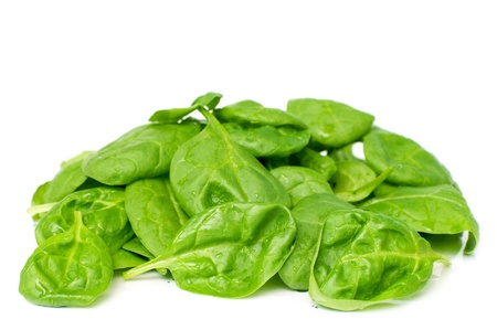 Pile of fresh spinach isolated on white, selective focus