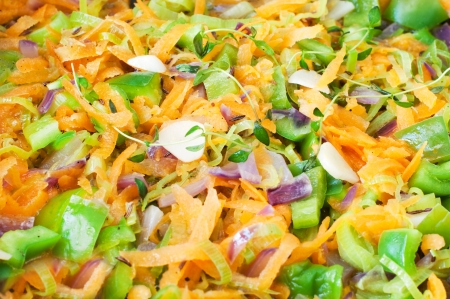 A medley of cooked vegetables - carrot, green paprika, leek, thyme, red onion  Selected focus