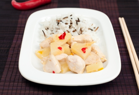Close up of chicken fillet with pineapple sauce and rice mix, selective focus, horizontal