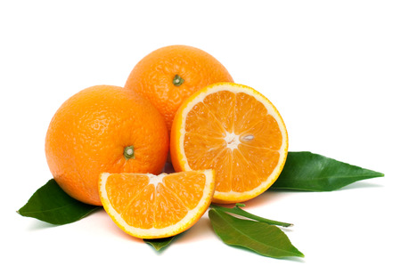 Fresh organic oranges and green leaves, isolated on white, horizontal