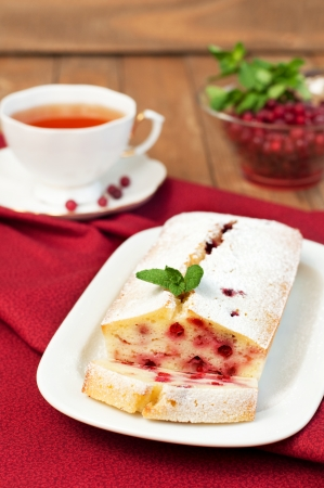 Close up of tasty semolina cranberry cake on wooden table, vertical Stock Photo