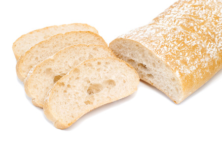 Partly sliced fresh ciabatta bread, isolated on white
