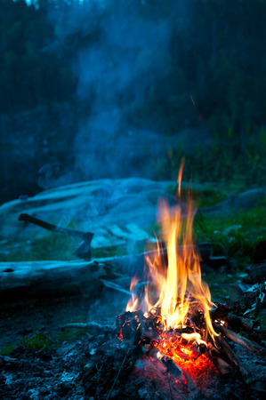 bonfire night: Camp fire on the river bank, vertical Stock Photo