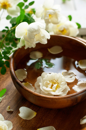 Aroma spa set with white roses, toned, selective focus