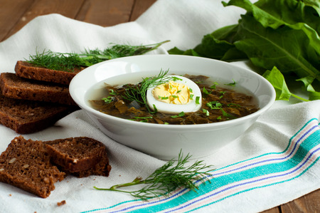 sour grass: Tasty soup with sorrel and egg, selective focus, horizontal