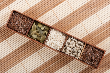 Brown flax seeds, pumpkin seeds,sesame seeds and sunflower seeds photo