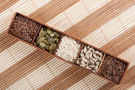 dried gourd: Brown flax seeds, pumpkin seeds,sesame seeds and sunflower seeds Stock Photo