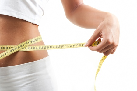 Woman measuring belly after diet Stock Photo