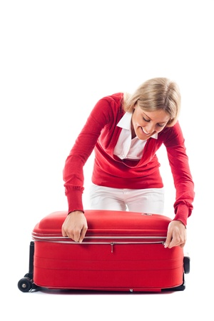 Young woman had packed for her trip and she is happy about it