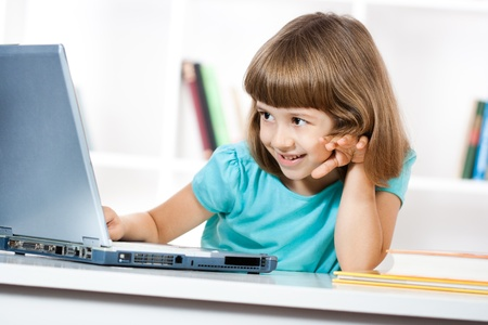 Little girl is having fun with her laptop Stock Photo