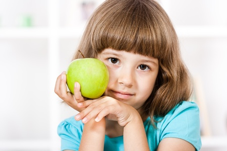 Beautiful little girl and apple Stock Photo
