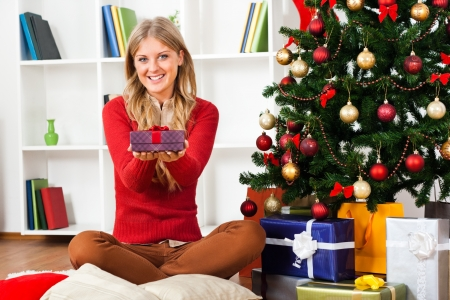 Young woman holding Christmas present Stock Photo