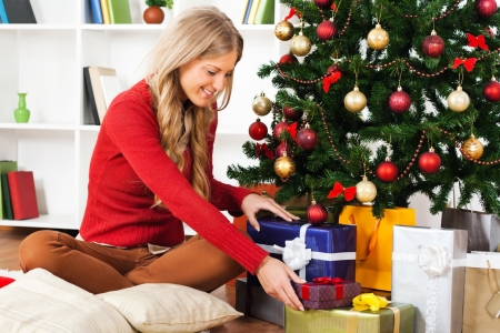 Beautiful young woman with Christmas presents photo