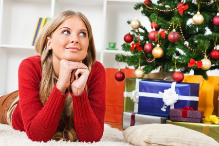 Young woman thinking about holidays Stock Photo