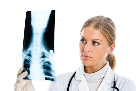 Young female doctor examining x-ray image Stock Photo - 16304597