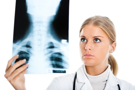 Young female doctor examining x-ray image photo