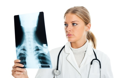Young female doctor examining x-ray image Stock Photo - 16441271