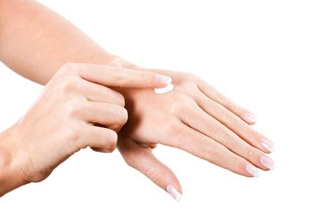 Close up of  female hands applying moisturizer