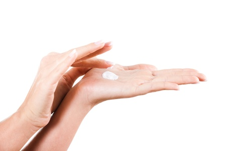 Close up of beautiful female hands applying moisturizer