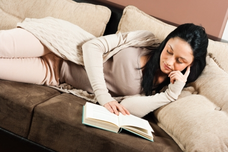 woman reading book: Young woman reading a book Stock Photo