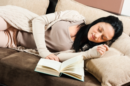 Beautiful young woman had fallen asleep while reading a book