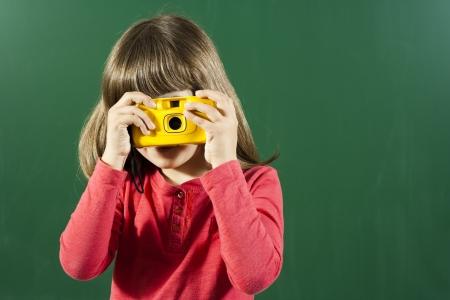 Little girl is taking photos  Stock Photo
