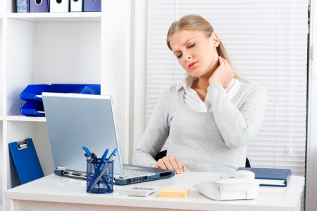 woman in pain: Businesswoman having pain in her neck