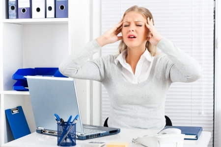 Businesswoman with too many problems and headache at work