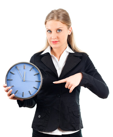 Businesswoman pointing at wall clock  Stock Photo