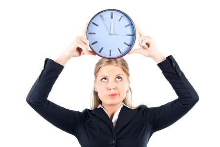 Businesswoman holding wall clock
